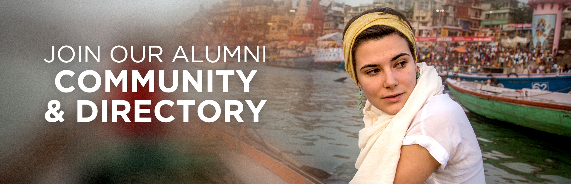 A young woman on a small boat turns toward the camera and looks past it. The left side is blurred with the text Join Our Alumni Community & Directory over it.